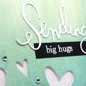 close up of sending big hugs handmade card