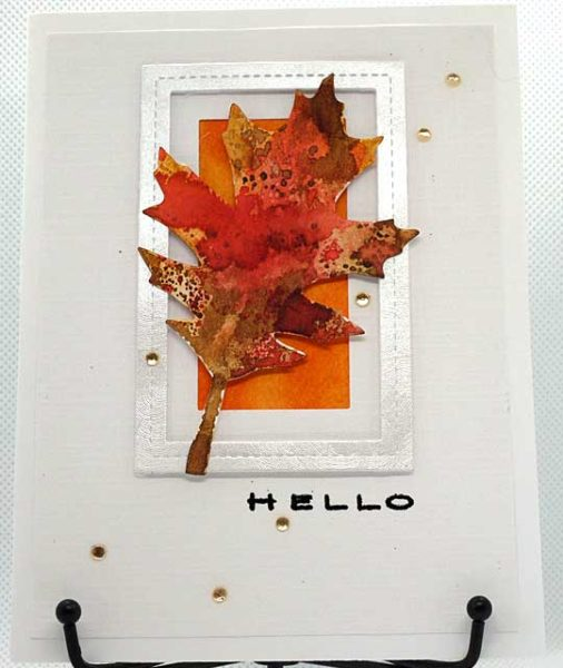 Front of finished Hello card with autumn leaf