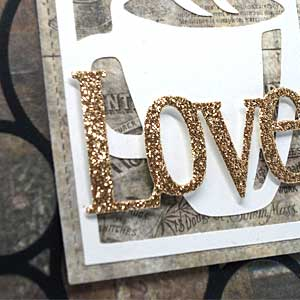 Close up of word love in glitter on front of card